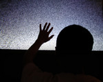 Free Picture of Man Touching a TV