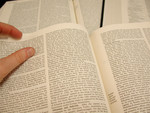Free Picture of Person Reading Information in an Encyclopedia