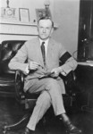Free Picture of Calvin Coolidge Seated at Desk