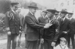 Free Picture of Calvin Coolidge Afixing a Medal on Augustus Butler Rowland