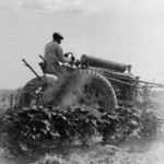 Free Picture of Man Riding a Tractor