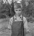 Free Picture of Migratory Boy in Squatter Camp