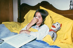 Free Picture of Child Blowing Her Nose and Resting in Bed - 1976