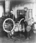 Free Picture of Blacksmith Fixing Bike