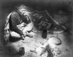 Free Picture of Navajo Indian Smoking by Fire