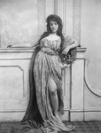 Free Picture of Woman Leaning on a Mantle