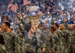 Free Picture of Uncle Sam Merged With Soldiers Waving American Flags