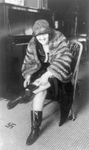 Free Picture of Woman Hiding a Flask in Her Boot During Prohibition
