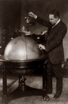Free Picture of John Phillip Hill Pouring Water on Globe, Prohibition