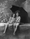 Free Picture of Little Boy and Girl Under Umbrella in Rain