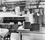 Free Picture of Pot Rack and Tables in a Kitchen
