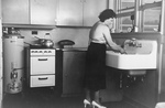 Free Picture of Woman in Her Kitchen