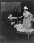 Free Picture of Doctor Inspecting a Child