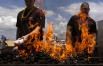 Free Picture of Sailors Using Lighter Fluid