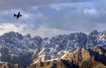 Free Picture of C-130 Hercules by Mountains
