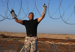 Free Picture of Installing Barbed Wire