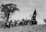 Free Picture of Pack Animals and People Near a Tipi