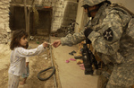 Free Picture of Soldier Giving Candy to a Girl