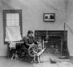 Free Picture of Woman Using a Spinning Wheel