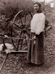 Free Picture of Woman and a Spinning Wheel