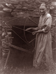 Free Picture of Woman by a Spinning Wheel