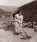 Free Picture of Woman Sweeping By a Spinning Wheel