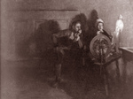 Free Picture of Man and Woman at a Spinning Wheel