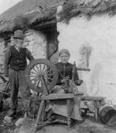 Free Picture of Couple With a Spinning Wheel