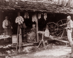 Free Picture of Family Using Spinning Wheels