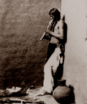 Free Picture of American Indian Playing an Instrument