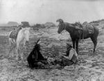 Free Picture of Native American and Caucasian Man Playing Cards