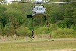 Free Picture of Soldiers Hanging on Ropes Under a Helicopter
