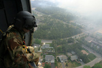 Free Picture of Soldier Overlooking a City From a Helicopter