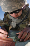 Free Picture of Soldier Using a Map and Compass