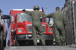 Free Picture of Soldiers Directing a Fire Truck