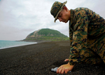 Free Picture of Soldier Collecting Sand From Iwo Jima