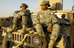 Free Picture of Two Female Army Soldiers on a Vehicle