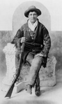 Free Picture of Calamity Jane Sitting With a Rifle