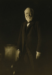 Free Picture of Andrew Carnegie Standing by a Chair