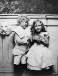 Free Picture of Little Boy Helping a Girl With a Cup