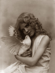 Free Picture of Angelic Girl Holding a Dove