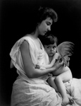 Free Picture of Mother Clipping Her Baby Angel's Wings