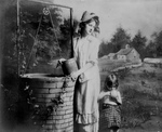 Free Picture of Woman and Daughter Fetching Water From a Well