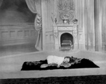 Free Picture of Girl Sleeping on a Rug Near a Fireplace