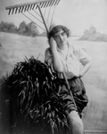 Free Picture of Woman With a Rake