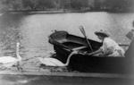 Free Picture of Helen Keller Feeding Two Swans