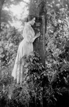 Free Picture of Helen Keller Resting Against a Tree
