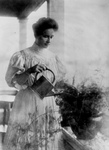Free Picture of Helen Keller Watering a Plant