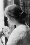 Free Picture of Helen Keller Holding Flowers