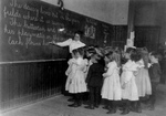 Free Picture of Students and Teacher at a Chalk Board